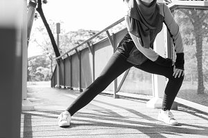 Islamic woman stretching body