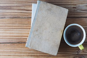 Mug of coffee and old books