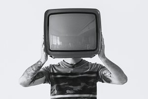 Person holding television
