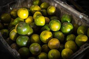 Fresh organic mandarins on the asian local market. Bali island.