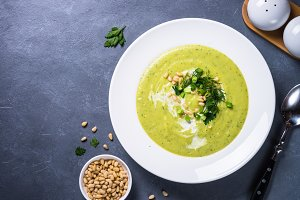 Cream soup with zucchini, herbs and cream.