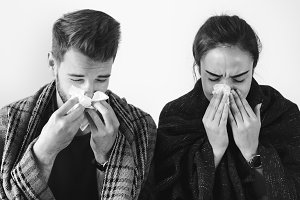 Sick couple with runny nose