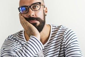 Closeup of bearded man looking bored