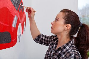 Woman  draws car