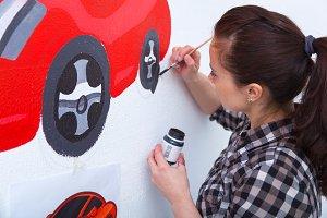 Woman  draws car