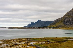Village along the coastline and high mountains on Lofoten islands