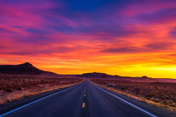 Dramatic sunset over an empty road…