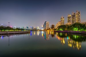 Lake Ratchada situated in the Benjakitti Park in Bangkok at nigh
