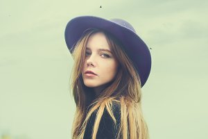 beautiful young girl in the hat