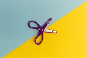 Scissors cutting paper line