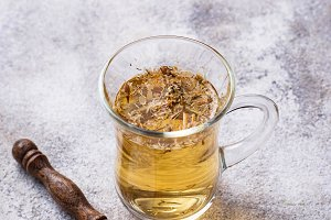 Healthy chamomile tea on light background