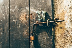 Close up view of iron lock on an weathered wooden door