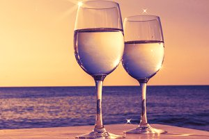 Glasses of wine at sunset