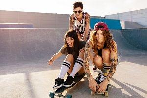 Girls having fun with skateboard