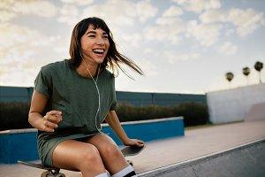 Cheerful woman at skate park