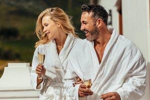 Couple wearing bathrobes in balcony