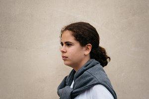 Beautiful girl against wall