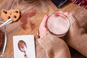 Hands with hot drink and chocolate