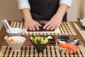 Woman chef ready to make sushi rolls