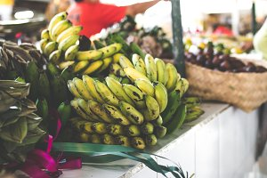 A bunch of medium raw and ripe cultivated banana on organic local market.