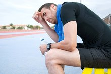 Man drinking water after exercise