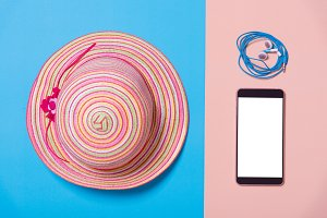 flat lay of fashion hat and smart ph