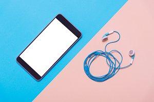 flat lay of smart phone and earphone