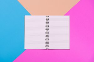 flat lay of note book on color pape