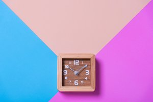 wood clock on color paper