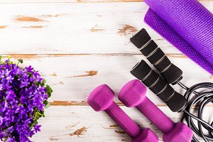 Ladies Sports Accessories, top view, wooden background