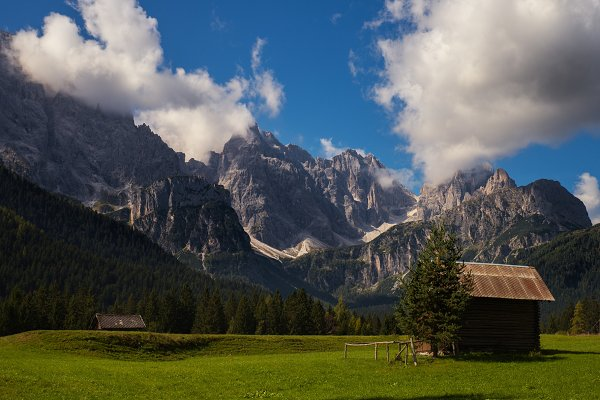 Stock Photos: Irantzu Arbaizagoitia - Green pastures and wooden huts