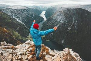 Brave traveler man raised hands