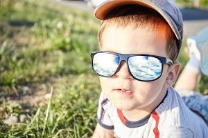 Child boy in sun glass
