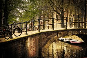 Romantic bridge over canal. Old town