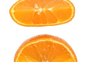 Two slices of tangerine isolated on white background. Top view. Flat lay