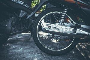Moped scooter wheel closeup.