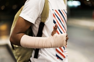Injured young man with arm support