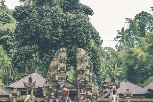 European woman in balinese temple. Bali island.