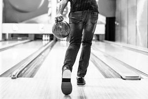 Boy about to roll a bowling ball