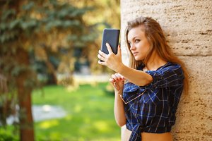 Girl doing a self-portrait on phone