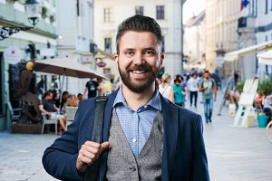 Hipster businessman in blue shirt in the city