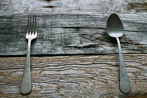 Spoon and fork on very old rustic wo