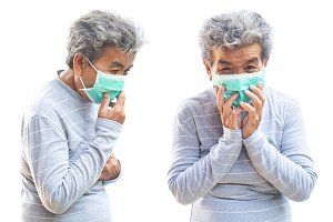 Old woman with mask coughing
