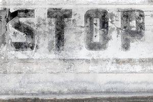 The word STOP painted on the wall
