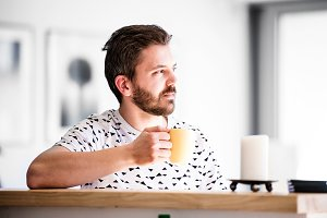 Businessman working from home, taking a break, drinking coffee
