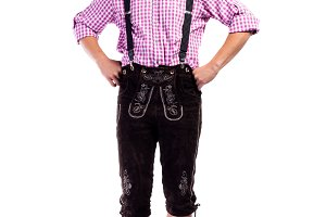Handsome hipster man in traditional bavarian clothes, isolated
