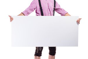 Handsome hipster man in traditional bavarian clothes, studio sho