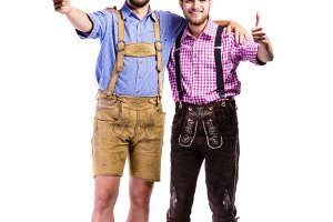 Two hipster men in traditional bavarian clothes, studio shot