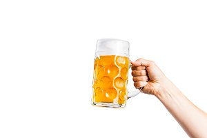 Unrecognizable man holding a beer mug, studio shot