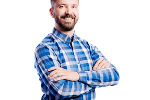 Hipster man in checked blue shirt, studio shot, isolated